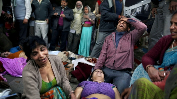 Indian man weeps for a relative killed in stampede