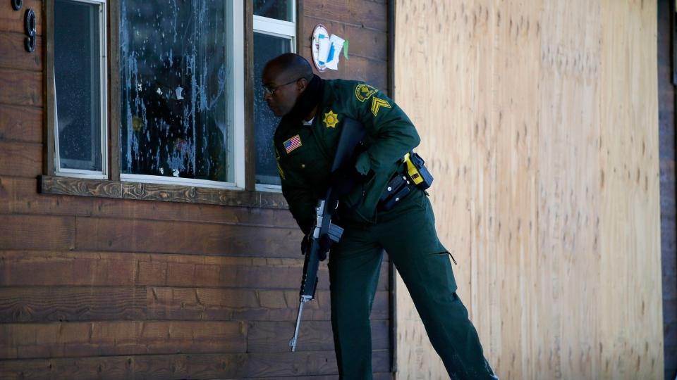 San Bernardino County Sheriff's officer Ken Owens searches a home for the former Los Angeles police officer Christopher Dorner in Big Bear Lake, Calif, Sunday, Feb. 10, 2013. (AP Photo / Jae C. Hong)