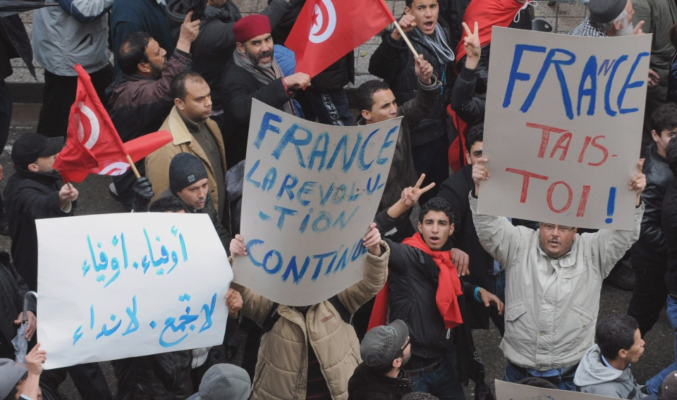 Protesters gather during a demonstration in Tunis on Saturday Feb 9, 2013.  (AP / Hassene Dridi)
