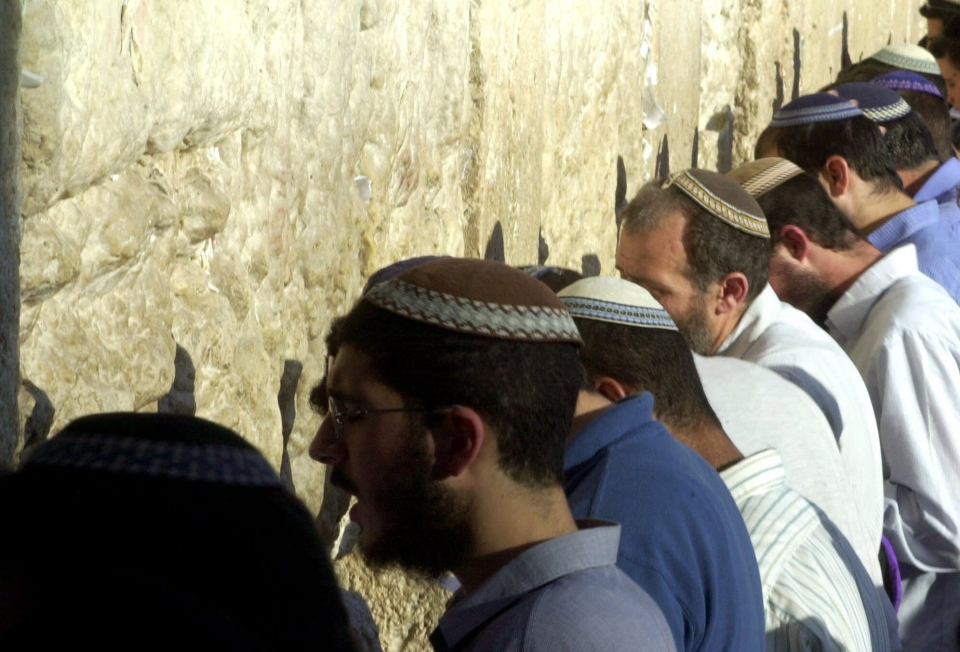 FILE -  Israelis say prayers at the Wailing Wall in Jerusalem, Judaism's holiest site, Tuesday, July 11, 2000. (AP Photo/Eyal Warshavsky)