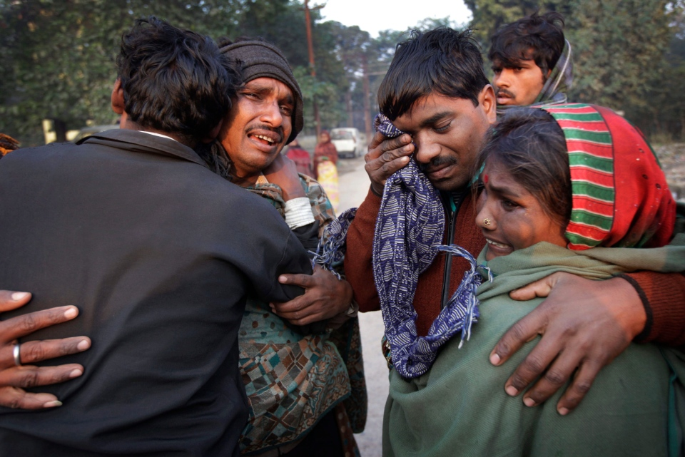 An Indian family whose relative died in a stampede at a railway station cry and comfort each other as they arrive to take the bodies from morgue, in Allahabad, India, Monday, Feb. 11, 2013. (AP / Rajesh Kumar Singh)