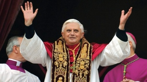 Emeritus Pope Benedict XVI is shown in this file photo greeting the crowd from the central balcony of St. Peter's Basilica moments after being elected, at the Vatican, April 19, 2005 (AP / Domenico Stinellis)
