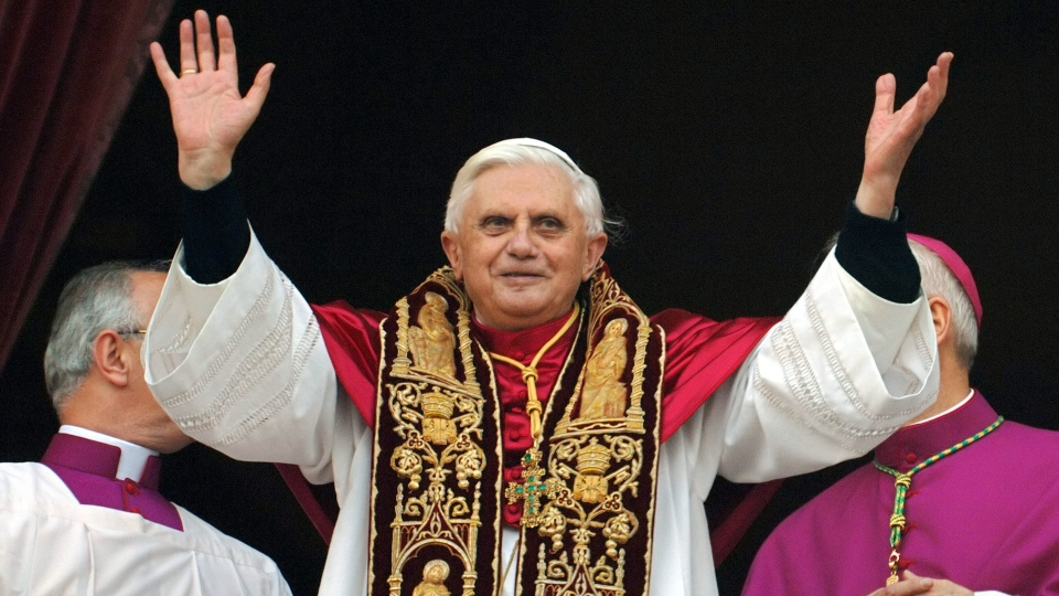 Pope Benedict XVI greets the crowd from the central balcony of St. Peter's Basilica moments after being elected, at the Vatican, April 19, 2005 (AP / Domenico Stinellis)