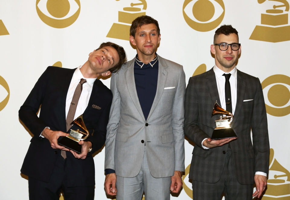 Members of fun., from left, Nate Ruess, Andrew Dost and Jack Antonoff, pose backstage with the song of the year award for