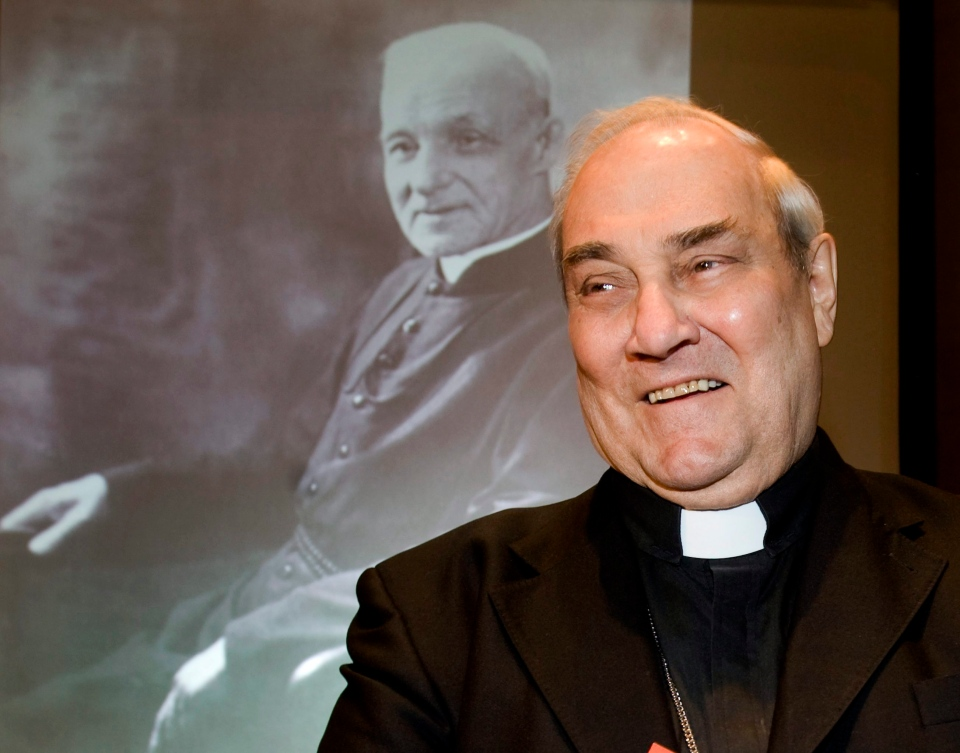 Cardinal Jean-Claude Turcotte stands next to a portrait of Brother André, prior to a news conference in Montreal, Friday, Feb. 19, 2010. (Graham Hughes / THE CANADIAN PRESS)