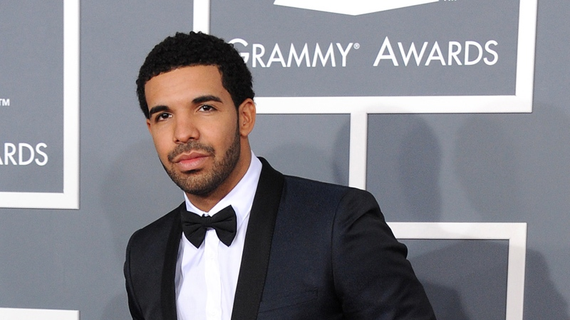 Drake arrives at the 55th annual Grammy Awards on Sunday, Feb. 10, 2013, in Los Angeles. (Photo by Jordan Strauss/Invision/AP)