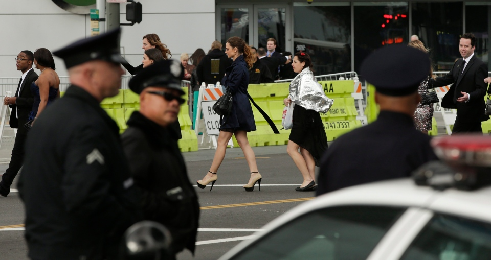 Extra police officers patrol outside the entrance to the 55th annual Grammy Awards in Los Angeles, Sunday, Feb. 10, 2013. (AP Photo/Chris Carlson)