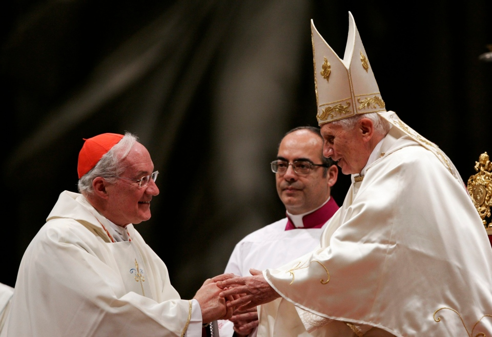 Pope Benedict XVI greets Cardinal Marc Ouellet, of Canada, president of the Pontifical Commission for Latin America, left, at the beginning of a mass for Latin America, in St. Peter's Basilica at the Vatican, Monday, Dec. 12, 2011. (AP / Riccardo De Luca)
