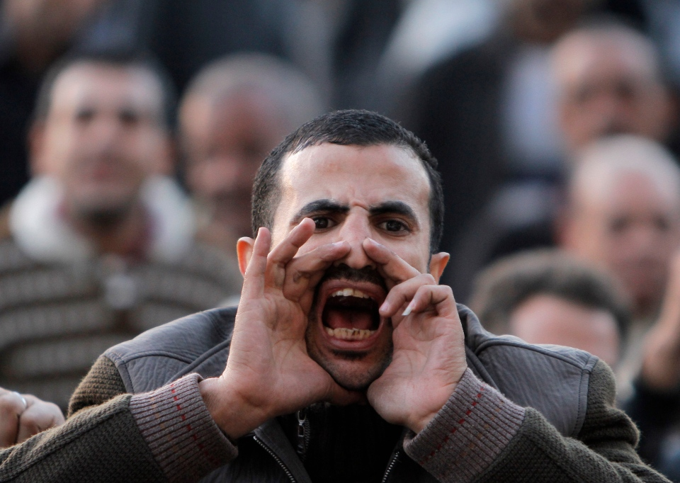 An Egyptian protester shouts anti-Muslim brotherhood slogans during a demonstration marking the second anniversary of former President Hosni Mubarak's resignation in Tahrir Square, Cairo, Egypt on Feb. 11, 2013. (AP Photo/Amr Nabil)