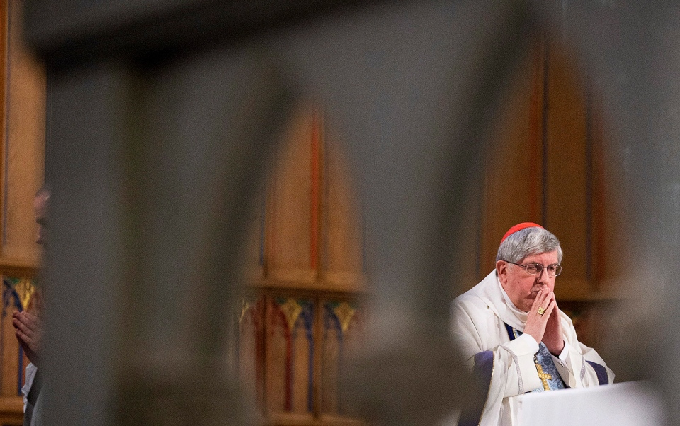 Archbishop Thomas Collins of Toronto prays during mass before speaking to the media regarding Pope Benedict XVI resignation on Monday, Feb. 11, 2013. (Michelle Siu / THE CANADIAN PRESS)