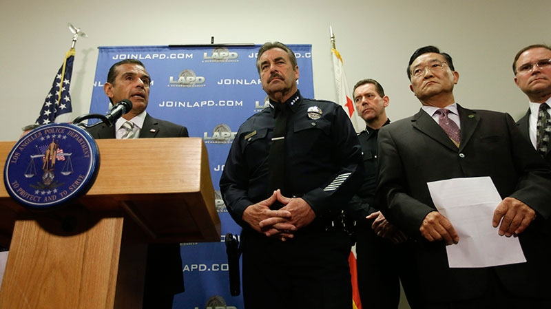 Los Angeles Mayor, Antonio Villaraigosa, left, talks about the $1,000,000 reward for accused killer and fired Los Angeles police officer, Christopher Dorner, in Los Angeles, Sunday, Feb. 10, 2013. (AP / Chris Carlson)