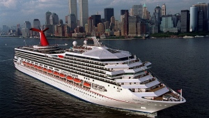 This handout file photo provided by Carnival Cruise Lines shows the MS Carnival Triumph departing New York harbor, on her inaugural voyage, July 27, 1999. (AP / Carnival Lines, Andy Newman)