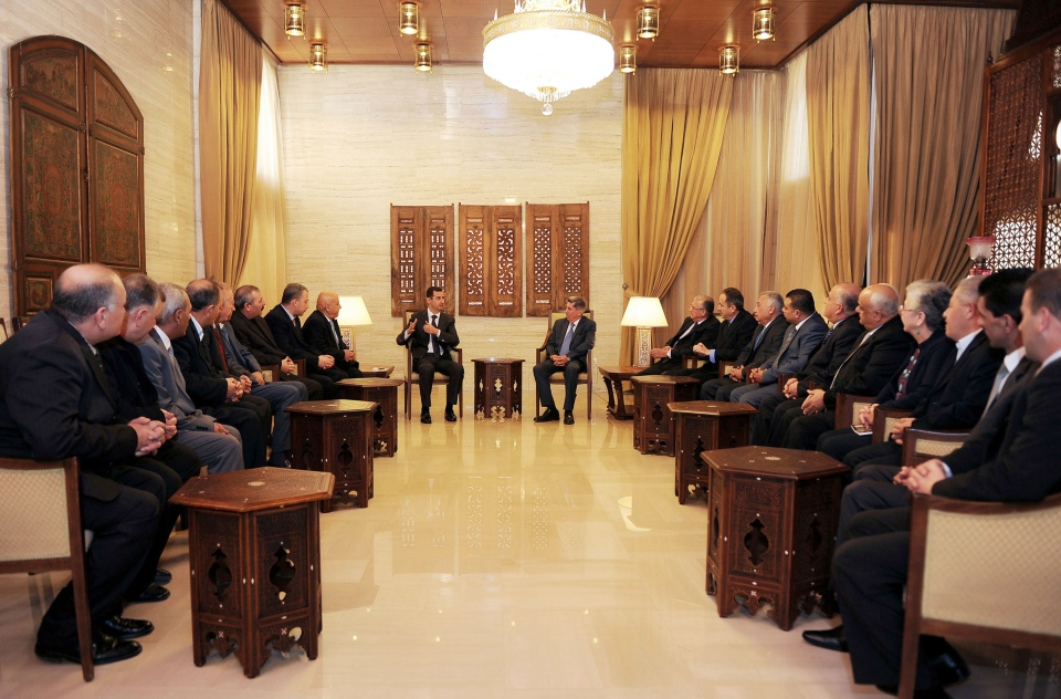 Syrian President Bashar Assad, centre left, meets with a delegation of Jordanian political activists, lawyers, doctors and engineers in support of him, in Damascus, Syria, Monday, Feb. 11, 2013. (SANA)