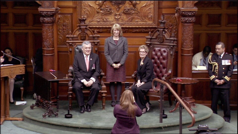 Ontario Premier Kathleen Wynne poses with Ontario Lt.-Gov. David Onley, and Minister for Intergovernmental Affairs and Women's Issues Laurel Broten, at her swearing in ceremony at Queen's Park in Toronto, Monday, Feb. 11, 2013.
