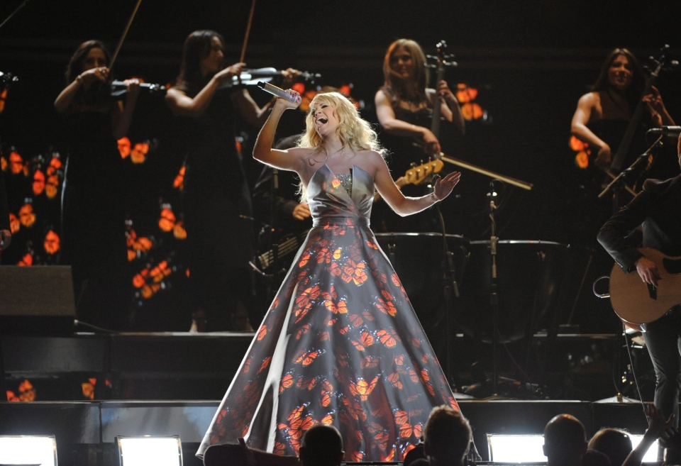 Carrie Underwood performs on stage at the 55th annual Grammy Awards in Los Angeles on Sunday, Feb. 10, 2013. (Invision / John Shearer)