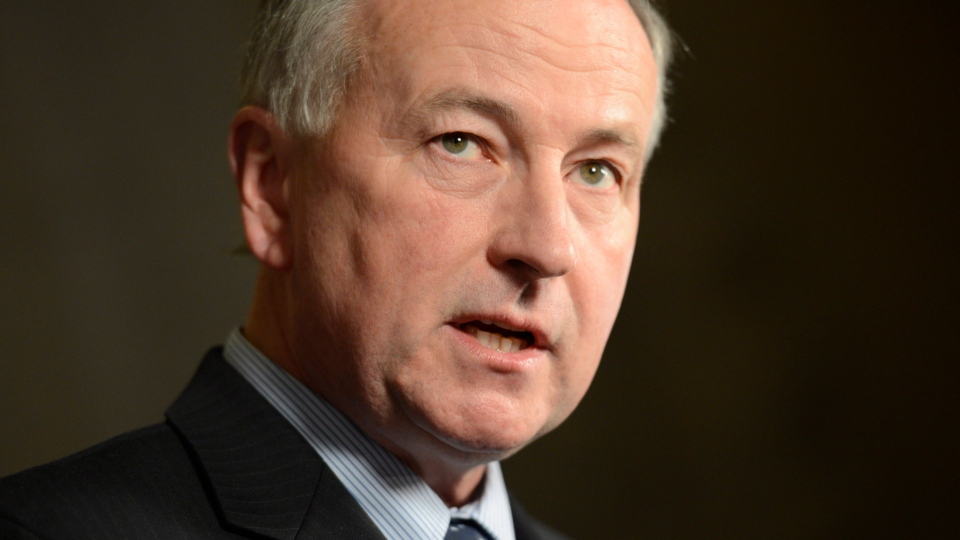 Rob Nicholson speaks with the media in the foyer of the House of Commons in Ottawa on Monday, Feb. 11, 2013. (Adrian Wyld / THE CANADIAN PRESS)