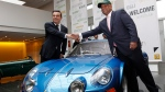 Renault CEO Carlos Ghosn, left, shake hands with Caterham CEO Tony Fernandez following their joint news conference at Renault headquarters in Paris, Monday Nov. 5, 2012. (AP Photo/Jacques Brinon)