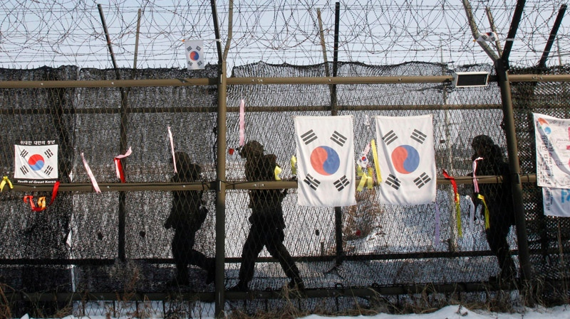South Korean army soldiers patrol along a barbed-wire fence at the Imjingak Pavilion, near the demilitarized zone of Panmunjom, in Paju, South Korea, Sunday, Feb. 10, 2013. (AP / Ahn Young-joon)