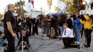 Los Angeles police Lt. Andrew Neiman, left, takes questions from the media at news conference about conviction of former police officer Christopher Jordan Dorner, outside the LAPD headquarters downtown Los Angeles Monday, Feb 11, 2013. (AP Photo / Nick Ut)