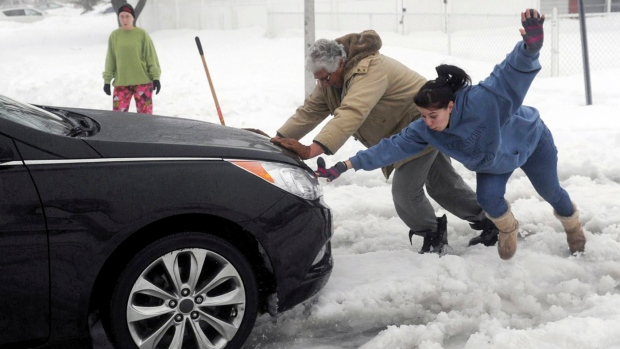 Woman loses her footing helping stranded motorist
