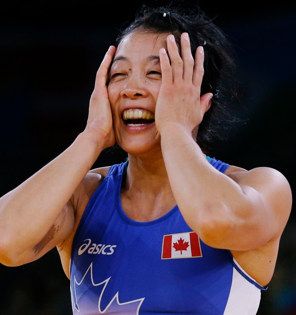 Carol Huynh of Canada, celebrates her win over Isabelle Sambou of Senegal after their 48-kg women's freestyle wrestling bronze medal match at the 2012 Summer Olympics, Wednesday, Aug. 8, 2012, in London. (AP Photo/Paul Sancya)