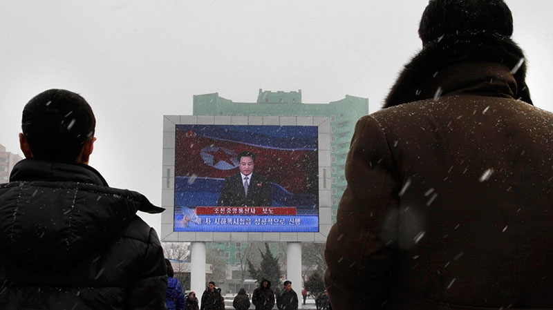 On a large television screen in front of Pyongyang's railway station, a North Korean state television broadcaster announces the news that North Korea conducted a nuclear test on Tuesday, Feb. 12, 2013. (AP / Jon Chol Jin)