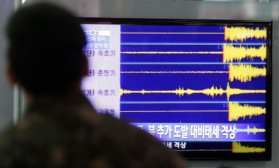 A South Korean soldier watches a TV screen reporting seismic waves of North Korea's nuclear test at Seoul train station in Seoul, South Korea, Tuesday, Feb. 12, 2013. (AP / Lee Jin-man)