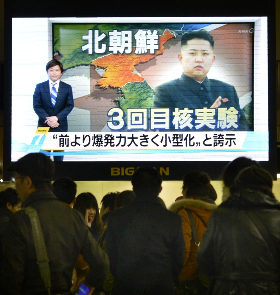 People watch a TV news in Osaka, western Japan, showing a North Korean leader Kim Jong Un with letters saying 'North Korea, Third nuclear test' Tuesday, Feb. 12, 2013. (Kyodo News)