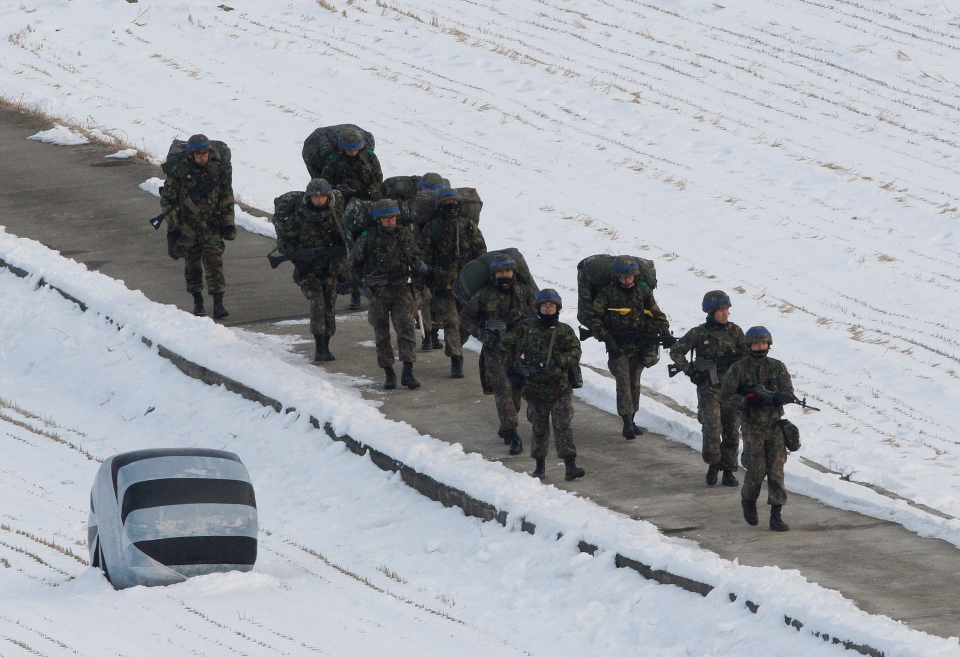 South Korean army soldiers patrol near the demilitarized zone of Panmunjom in Paju, South Korea, Tuesday, Feb. 12, 2013. (AP / Ahn Young-joon)