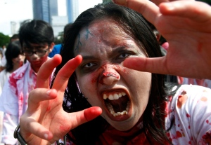 A participant dressed as a zombie performs during the annual Zombie Walk in Jakarta, Indonesia, Sunday, Jan. 27, 2013. (AP/Achmad Ibrahim)