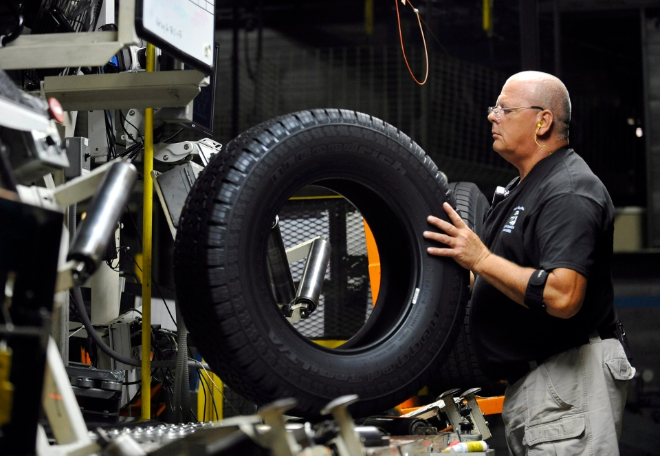 Tire inspector Buddy Rice checks for defects in the tire verification area at a Michelin manufacturing plant in Greenville, S.C., Tuesday, July 24, 2012. (AP / Rainier Ehrhardt)