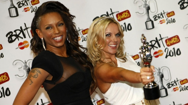 Former Spice Girls Geri Halliwell, right and Mel B with their Brit Award for Best British Performance over the last 30 years for Wannabe by the Spice Girls at the 2010 Brit Awards in London, Tuesday, Feb. 16, 2010. (AP Photo/ Alastair Grant)