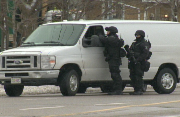 Heavily armed police officers are seen during a standoff on Weber Street East in Kitchener, Ont., on Tuesday, Feb. 12, 2013. (CTV Kitchener)