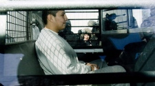 Christopher Pauchay is escorted from Rose Valley, Sask. court on Friday, March 6, 2009 where he was sentenced to 3 years in prison for criminal negligence causing death, from a 2008 incident at Yellow Quill First Nation where his two daughters froze to death in -50 C windchill weather. (THE CANADIAN PRESS/Geoff Howe)