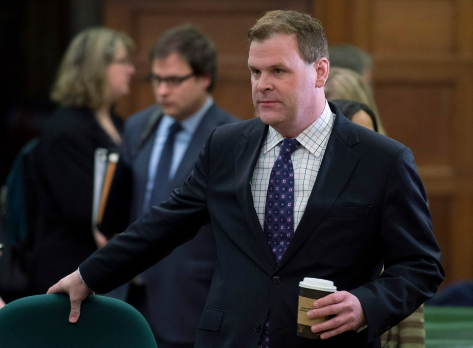 Minister of Foreign Affairs John Baird waits to appear before the Standing Committee on Foreign Affairs and International Development on Parliament Hill  in Ottawa on Tuesday, Feb. 12, 2013. (Adrian Wyld / THE CANADIAN PRESS)
