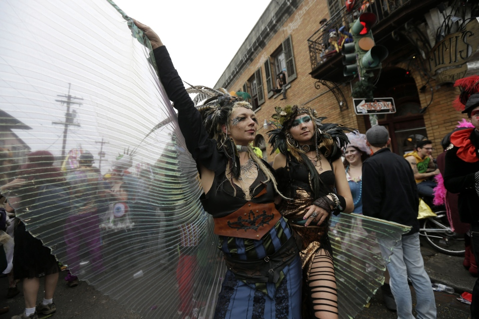Revelers show off their costumes as they march through the Bywater section of New Orleans during the Society of Saint Anne walking parade during Mardi Gras day, Tuesday, Feb. 12, 2013. (AP / Gerald Herbert)