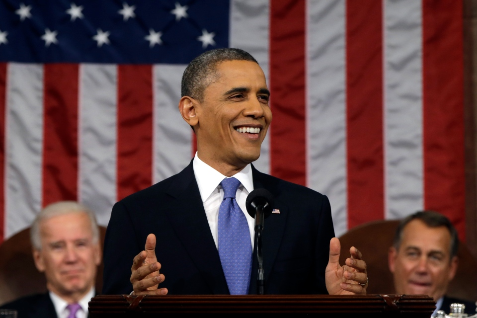 U.S. President Barack Obama, flanked by Vice President John Biden and House Speaker John Boehner smiles as he gives his State of the Union address during a joint session of Congress on Capitol Hill in Washington, Tuesday Feb. 12, 2013. (AP / Charles Dharapak)