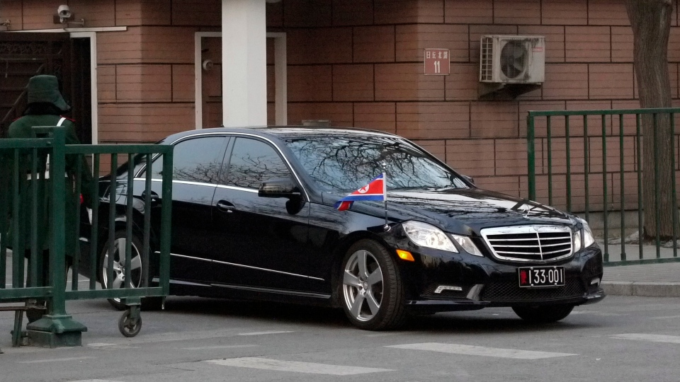 The car of the North Korean ambassador to China emerges from the North Korean embassy in Beijing, Tuesday Feb. 12, 2013, hours after North Korea conducted its third nuclear test. (AP Photo)