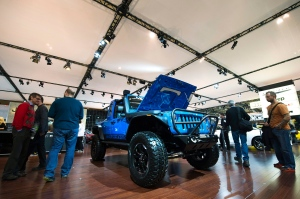 In this Friday, Feb. 17, 2012 file photo, people check out a Jeep Rubicon concept vehicle on display at the 2012 Canadian International Auto Show in Toronto. (THE CANADIAN PRESS/Nathan Denette)