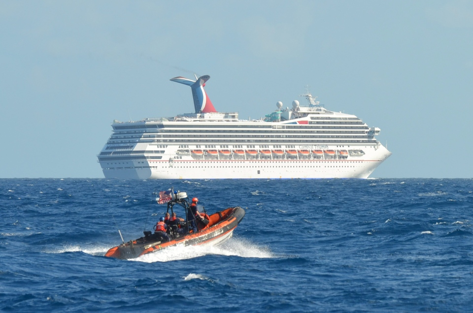 In this image released by the U.S. Coast Guard on Feb. 11, 2013, a small boat belonging to the Coast Guard Cutter Vigorous patrols near the cruise ship Carnival Triumph in the Gulf of Mexico, Feb. 11, 2013. (AP Photo/U.S. Coast Guard- Lt. Cmdr. Paul McConnell)