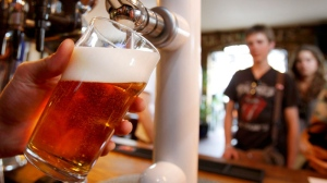 A pint of beer is pulled in a pub in London, Monday, July 28, 2008. (AP / Kirsty Wigglesworth)