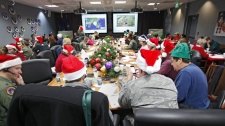 Volunteers take phone calls and answer emails at the Santa Tracking Operations Center at Peterson Air Force Base near Colorado Springs, Colo., on Friday, Dec. 24, 2010. (AP Photo/Ed Andrieski)
