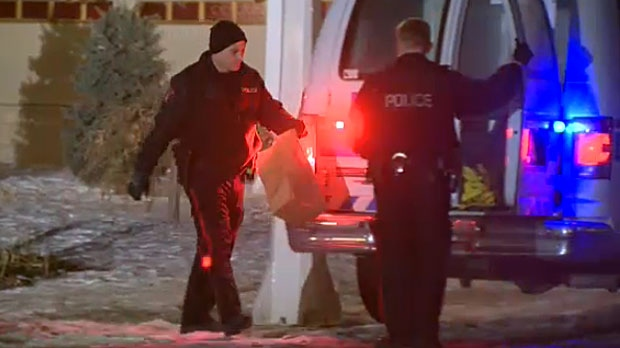 Police collect evidence from the scene of a stabbing in southwest Calgary early Wednesday morning.
