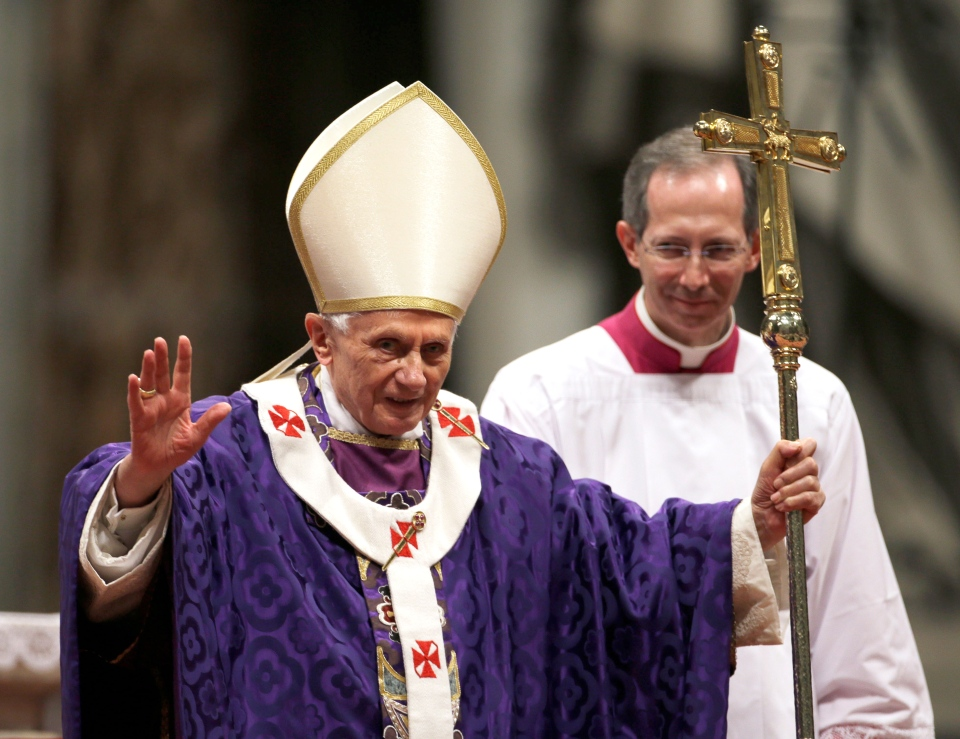 Pope Benedict XVI greets the faithful at the end of the Ash Wednesday mass in St. Peter's Basilica at the Vatican, Wednesday, Feb. 13, 2013. (AP / Gregorio Borgia)