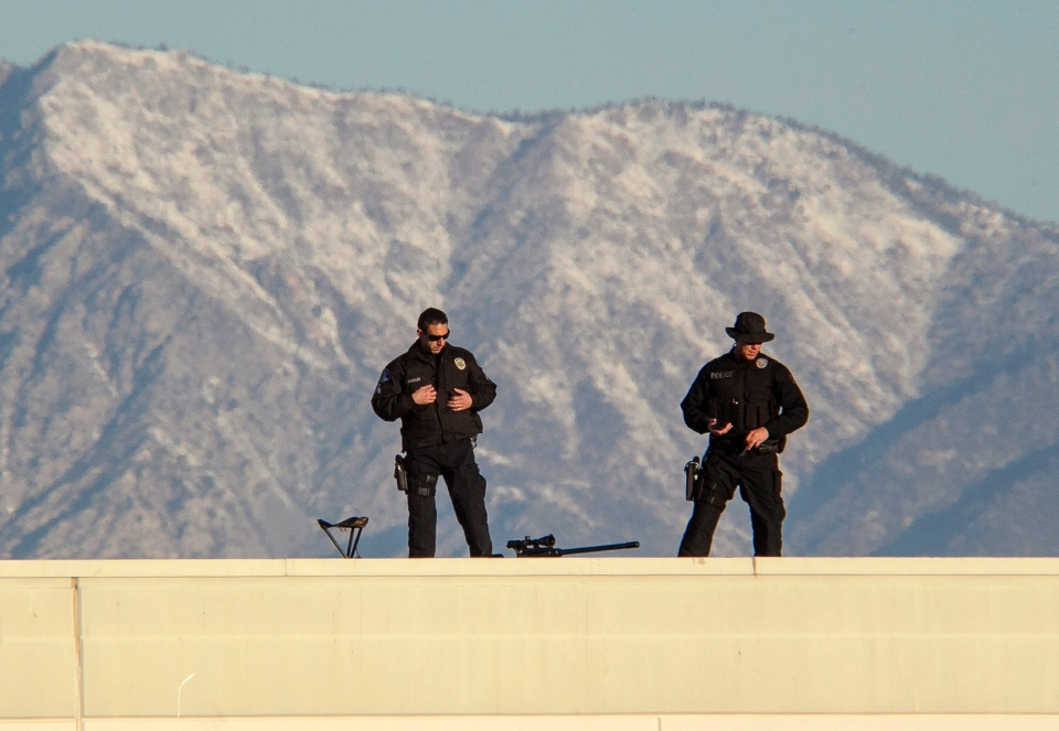 Police sharpshooters are stationed on the roof of the Grove Community Church as hundreds of police officers mourn Riverside Officer Michael Crain gunned down a week ago during an alleged revenge rampage by ex-Los Angeles policeman Christopher Dorner in Riverside, Calif., Wednesday, Feb. 13, 2013. (AP / Damian Dovarganes)