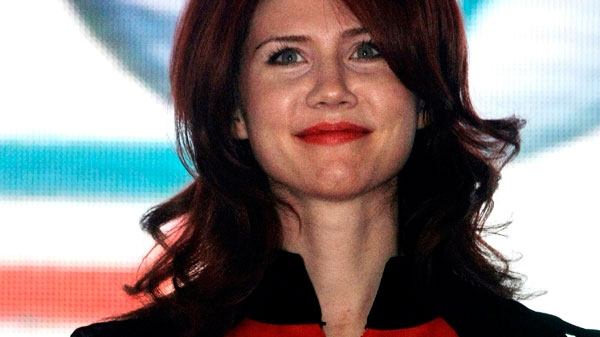 In this Dec. 22, 2010 file photo, Anna Chapman, who was deported from the U.S. on charges of espionage, is seen onstage during an event with leaders of the Young Guards, a pro-Kremlin youth movement, Moscow, Russia. (AP / Mikhail Metzel, File)