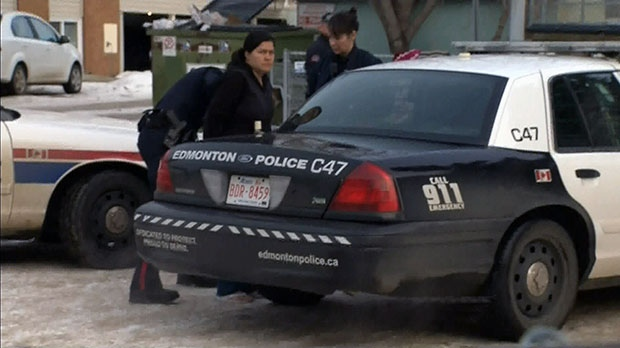 Police arrest 32-year-old Nerlin Sarmiento in Edmonton on Wednesday, Feb. 13, 2013.