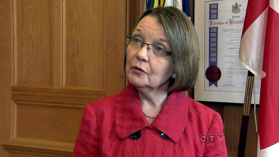 B.C. Justice Minister Shirley Bond says she is not intending to change the law regarding Vancouver bus drivers being exempt from red-light ticket fines, Wednesday, Feb. 13, 2013.