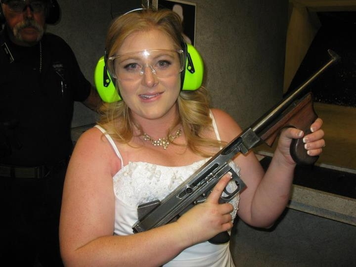 "This July 28, 2012 photo provided by Bob MacDuff shows Lindsae MacDuff holding an automatic weapon at the Gun store in Las Vegas after her ""shotgun wedding."" One Las Vegas shooting range is selling ""take a shot at love"" packages that include 50 submachine gun rounds. (AP Photo/Bob MacDuff)"