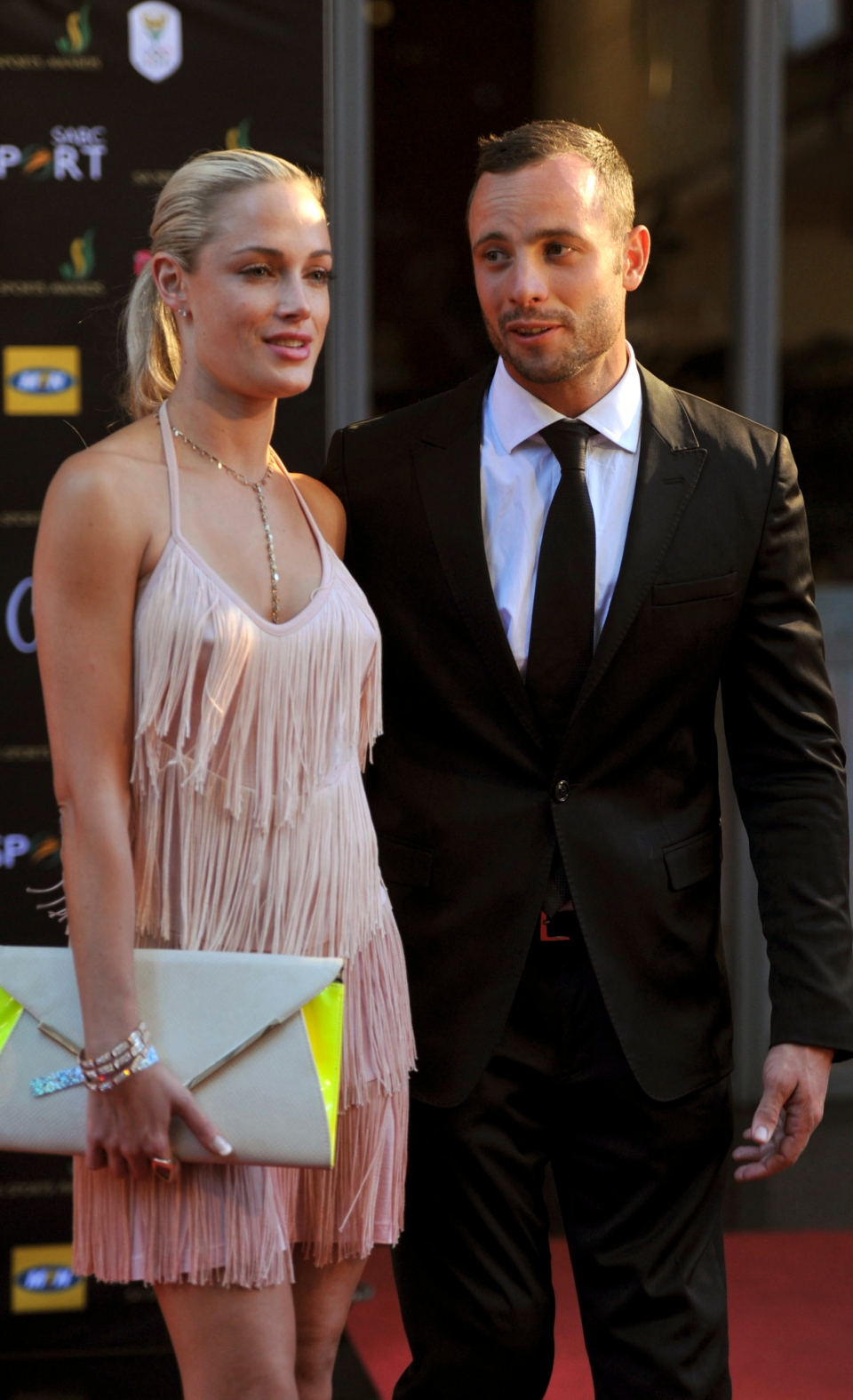 Oscar Pistorius and Reeva Steenkamp at an awards ceremony in Johannesburg, South Africa last year. The Olympic athlete has been charged with the murder of his girlfriend after the model was shot inside the athlete's home. (AP / Lucky Nxumalo-Citypress)
